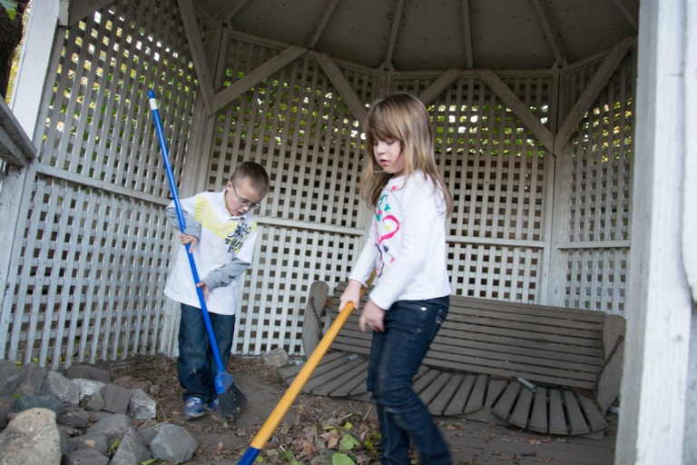The first of the kids to arrive took to sweeping up the gazebo... to each their own, eh?